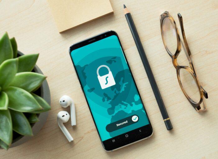 black iphone 5 beside brown framed eyeglasses and black iphone 5 c
